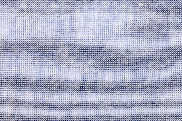 Fond bleu clair à partir d'un matériau textile avec motif en osier, gros plan.