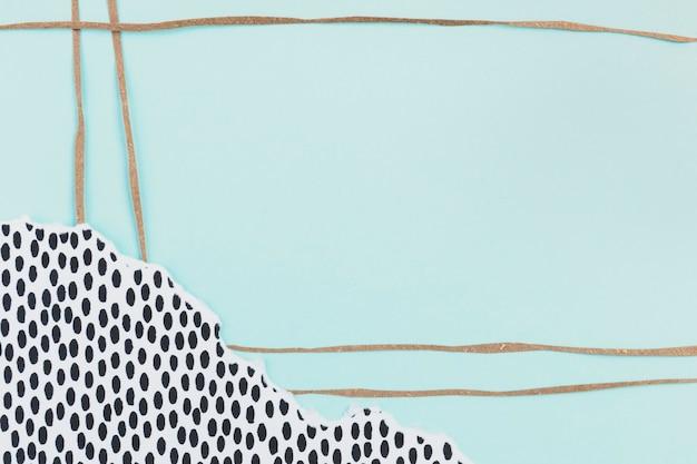 Fond bleu décoré de collage de papier