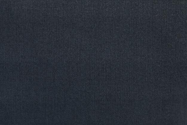 Fond bleu foncé d'un matériau textile
