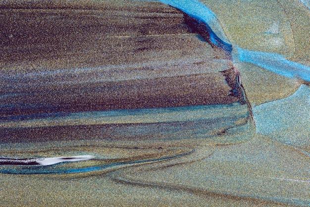 Fond bleu foncé avec des textures de peinture indigo. texture pailletée et couleurs sombres sur fond étincelant. minimalisme