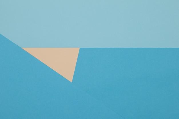 Fond bleu et jaune, le papier coloré se divise géométriquement en zones