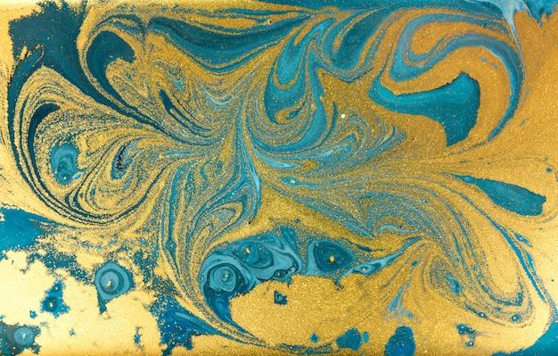 Fond bleu marbré. texture liquide en marbre doré.