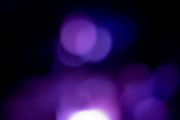 Fond bleu marine paillettes argent noël texture lumière abstraite étoiles scintillantes sur bokeh. fond de lumières vintage scintillantes