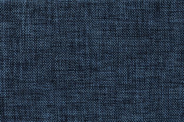 Fond bleu marine de tissu d'ensachage tissé dense, gros plan. structure de la macro textile.