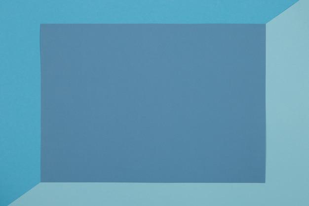 Fond bleu, papier coloré se divise géométriquement en zones