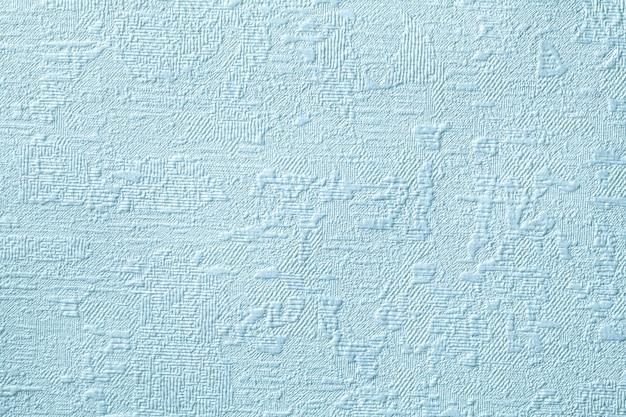 Fond bleu avec relief et texture ondulée.