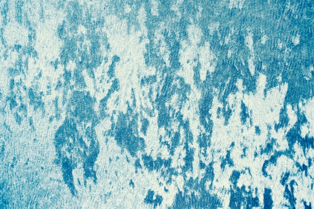Fond bleu texturé en tissu dense.