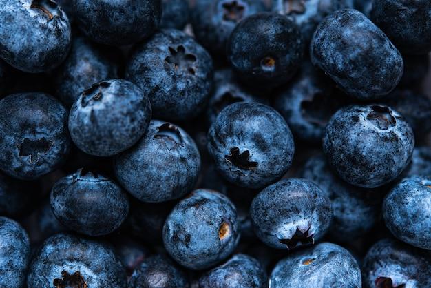 Fond de bleuets juteux frais. macro et vue de dessus