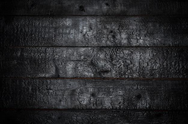 Fond en bois brûlé. les tableaux noirs horizontaux