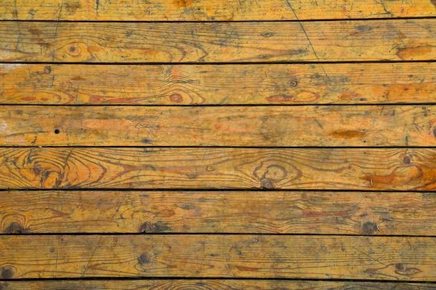 Fond de bois de grange patiné rustique avec noeuds et trous de clous