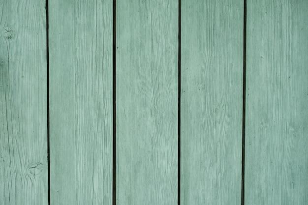 Fond en bois naturel fait de planches peintes en couleur menthe peinture pour surfaces en bois