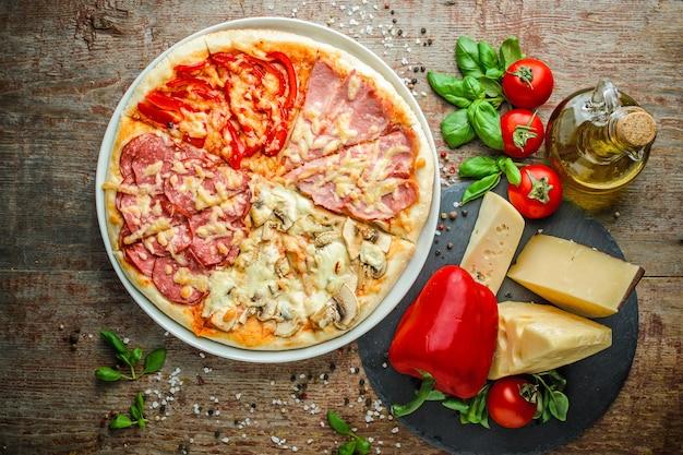 Fond en bois pizza quatre saisons