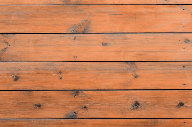 Fond en bois verni de l'extérieur de la cabine. planche de bois brun