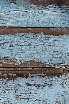 Fond de bois vintage avec peinture écaillée. texture du bois vieux