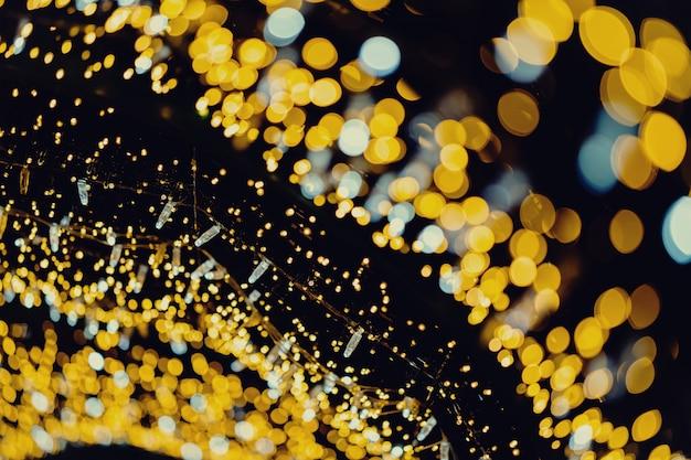 Fond de bokeh abstrait lumières nouvel an or