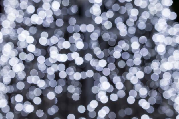 Fond de bokeh blanc argent abstrait