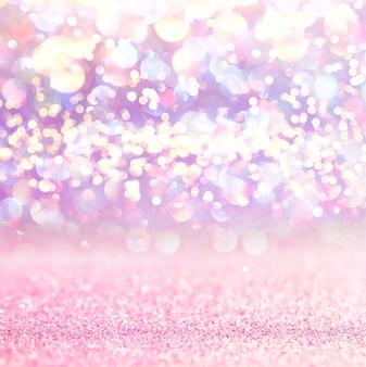 Fond de bokeh de lumières paillettes roses. défocalisé