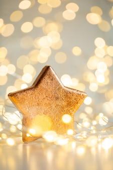 Fond de bokeh de noël avec étoile décorative