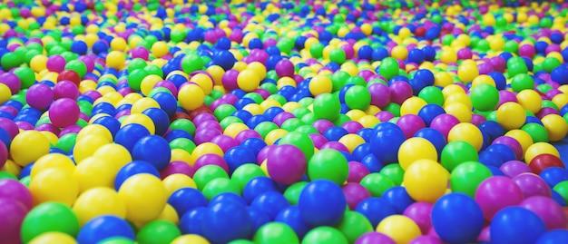 Fond de boules en plastique multicolores lumineuses