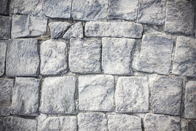 Fond de briques de pavage de pierres grises