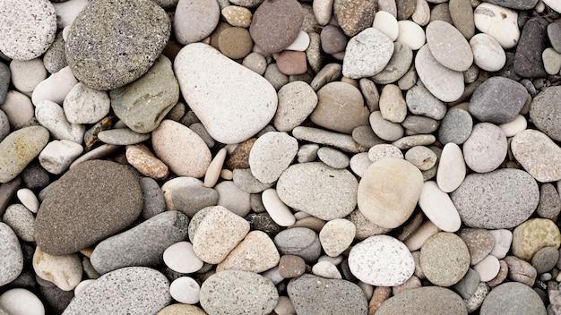 Fond de cailloux de roche blanche naturellement polis