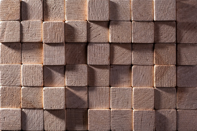 Fond de carrés en bois colorés