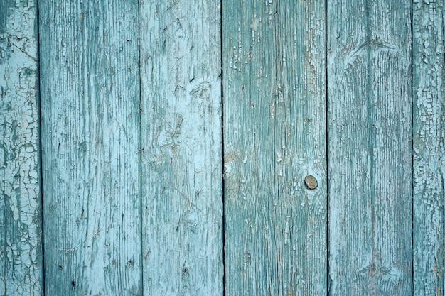 Fond de carte bleue. mur de vieilles planches.
