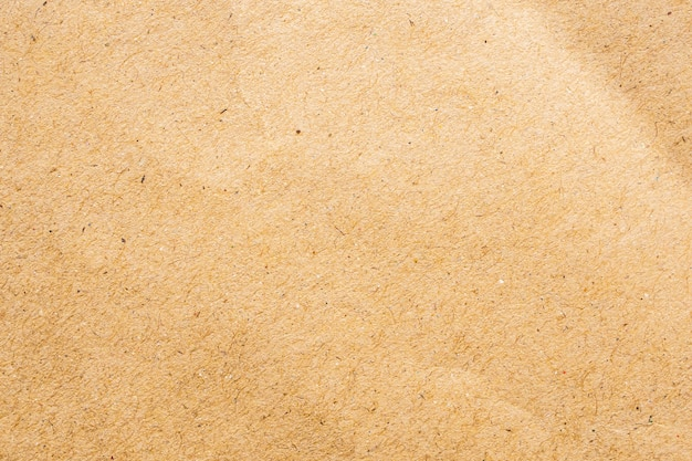 Fond de carton de texture de feuille de papier kraft recyclé écologique brun