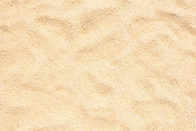 Fond de champ vide de texture de plage de sable jaune