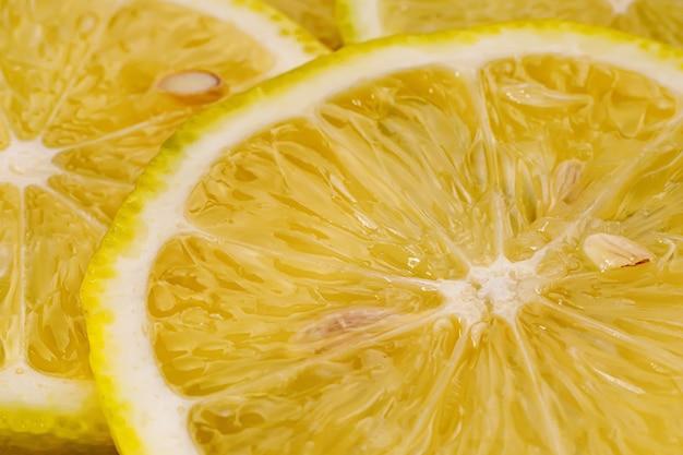 Fond de citron. vue rapprochée des tranches de citron.