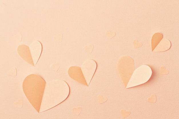 Fond de coeurs de papier