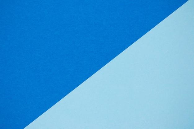 Fond de composition plat géométrie couleur papiers avec des tons bleus et verts