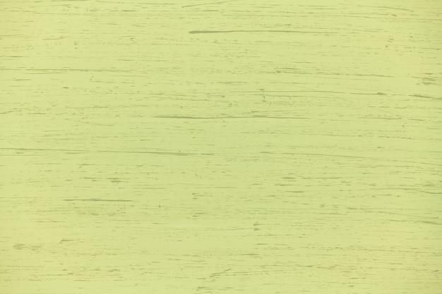 Fond de contreplaqué naturel peint de couleur unie vert jaune avec des coups de pinceau, neuf et propre