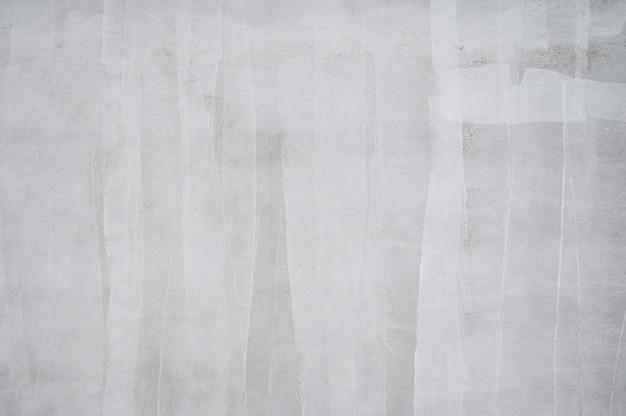Fond de couleur de motif d'apprêt blanc sur le mur de ciment.