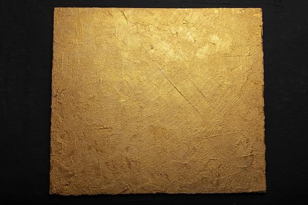 Fond de couleur or en relief texturé