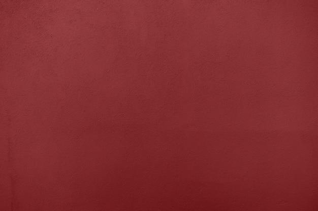 Fond de couleur plâtre rouge foncé