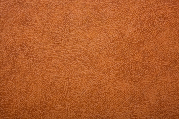 Fond en cuir texturé marron ou orange