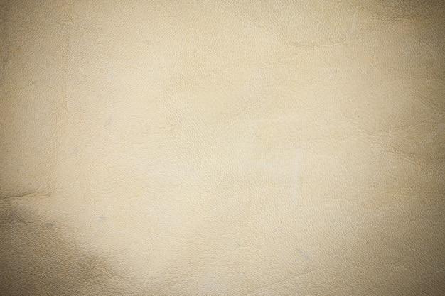 Fond en cuir véritable beige.