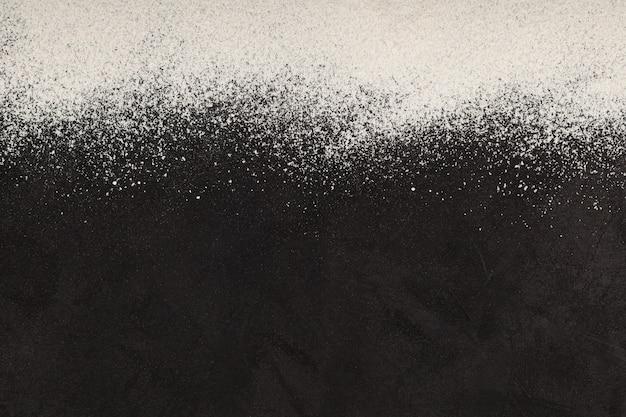 Fond de cuisson avec copie espace farine d'amande sur une surface texturée sombre farine sans gluten