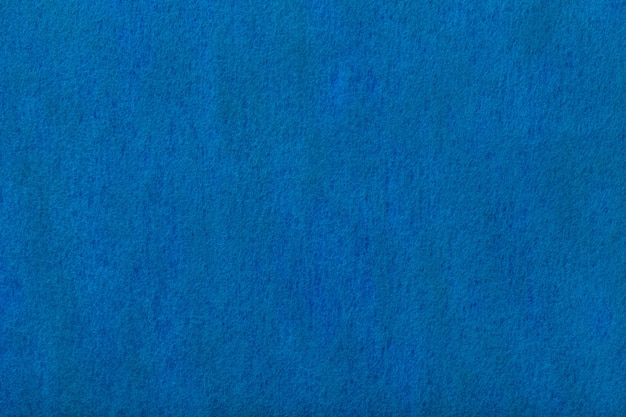 Fond en daim mat bleu marine. texture velours de feutre.