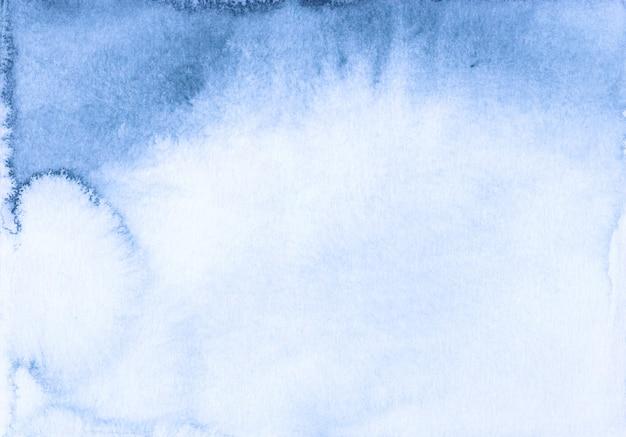 Fond dégradé bleu clair aquarelle. texture peinte à la main.