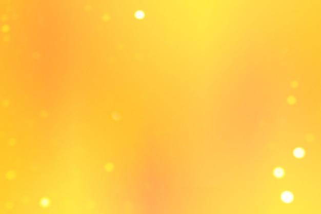 Fond dégradé lisse avec des couleurs jaunes et des lumières bokeh