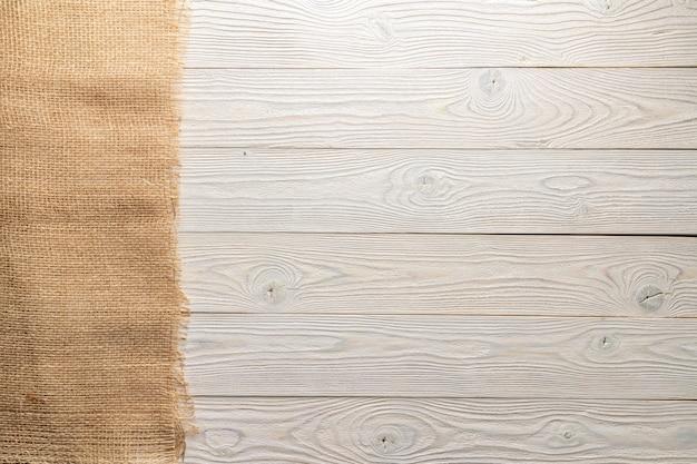 Fond dépouillé blanc avec vue de dessus de tissu rugueux