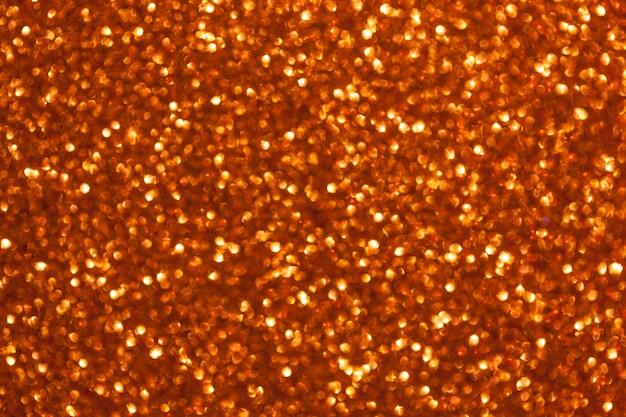 Fond doré brillant flou avec des lumières scintillantes
