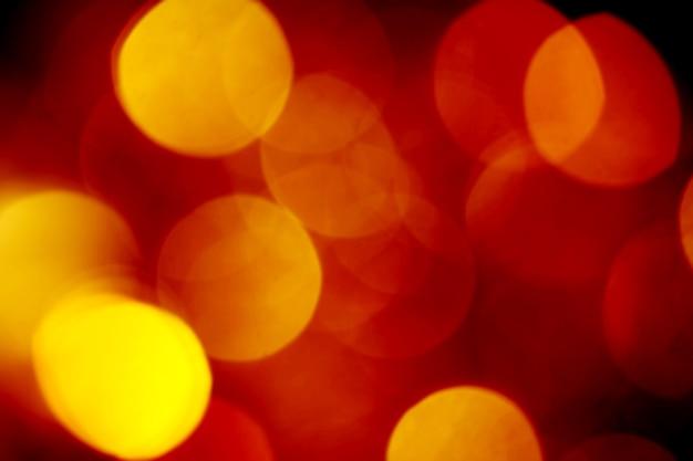 Fond doré brillant de lumières de noël, bokeh lumineux défocalisé