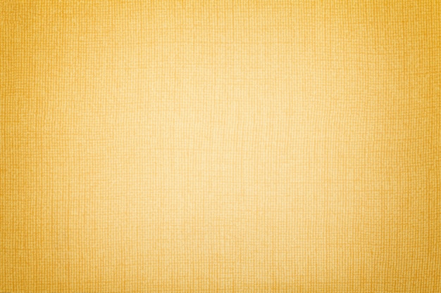 Fond doré d'une matière textile. tissu à texture naturelle.