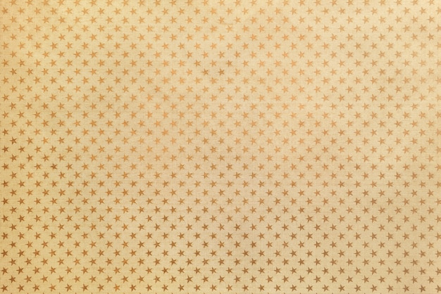 Fond doré de papier d'aluminium avec un motif d'étoiles