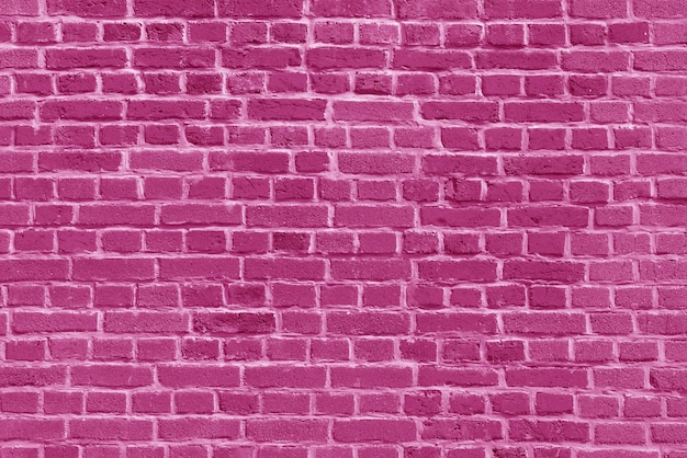 Le fond du vieux papier peint de mur de brique rose