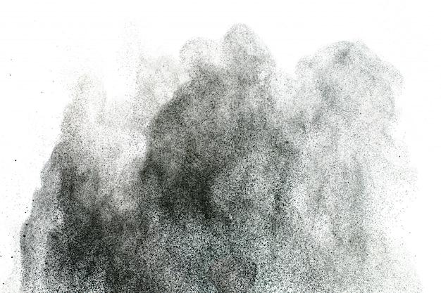Fond d'éclaboussures de poudre noire. texture des particules de poussière