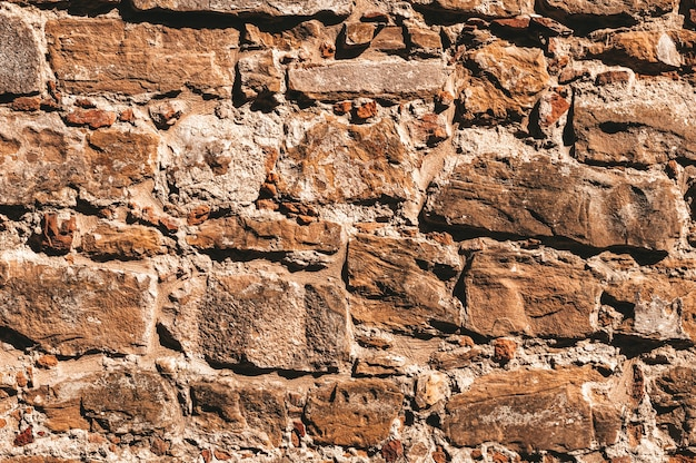 Fond d'écran d'un mur de pierre. ancienne pierre légèrement détruite. florence.